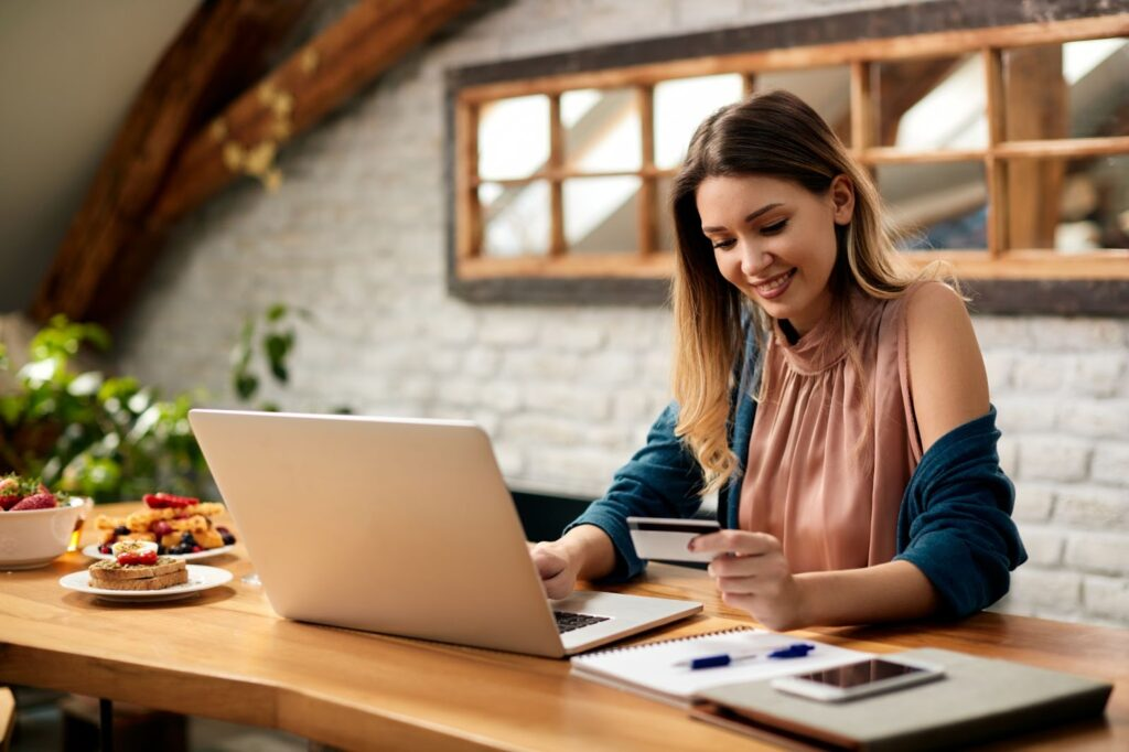 Credit card transaction fees: A woman uses a credit card to make an online purchase