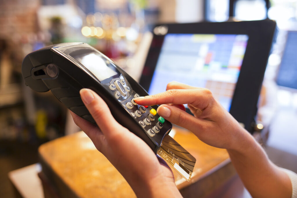 Cheapest way to accept credit card payments: A business scans a credit card