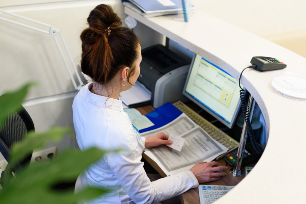 What is a surcharge: A receptionist works at a desk in an office