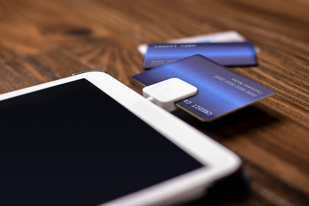 How to accept credit card payments on my phone: A credit card sits in a card reader attached to a tablet