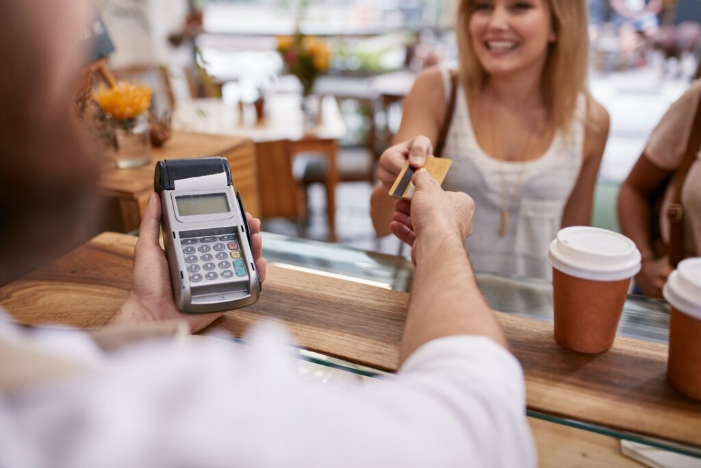 convenience fee: person handing over a credit card to a woman